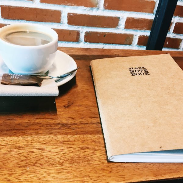 coffee and notebook on a desk