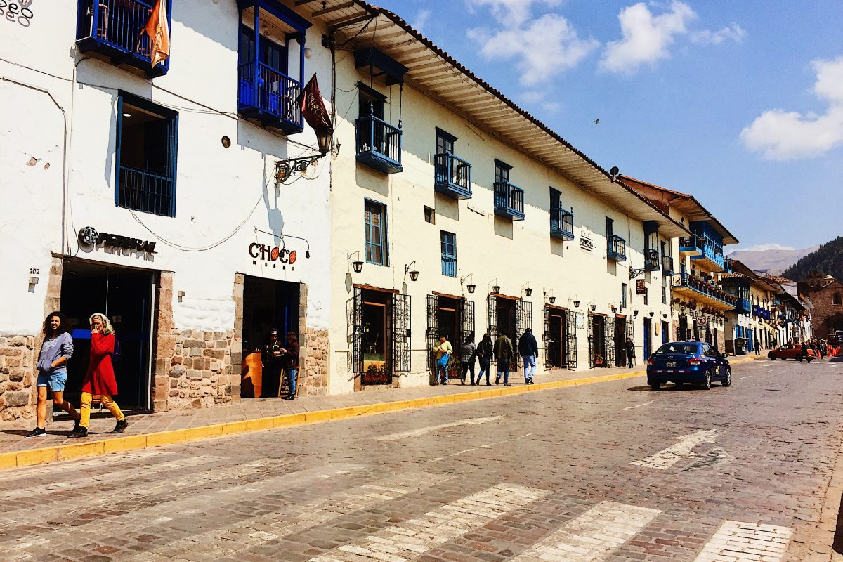 array of old buildings with flat tops on a clear sunny day, Cuzco, Peru
