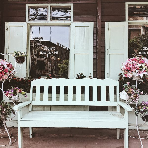 white bench with pink flowers